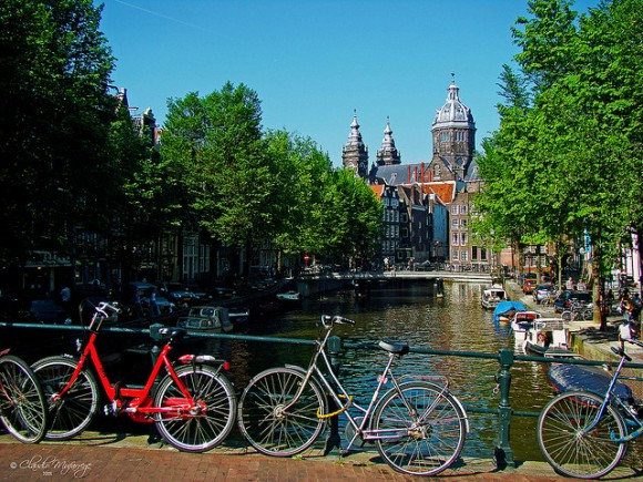 Bikes in Amsterdam by Claudio.Ar (creative commons)