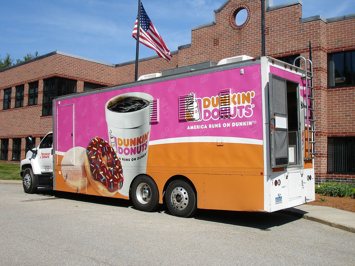 Business promotions like the Dunkin Donuts portable food truck generate buzz around a brand that can't be duplicated through other business activities ... photo by CC user Tianliu on wikimedia commons